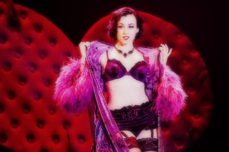 """Michelle L'amour performing her live burlesque striptease: """"Heart On"""" in BIG SEXY SHOW 2013, Park West, Chicago. Full Gallery at: http://mikewhite.photoshelter.com/gallery/Michelle-Lamours-BIG-SEXY-SHOW/G0000zzIVduJ74FA/C0000xMUGQ8W_pNs"""